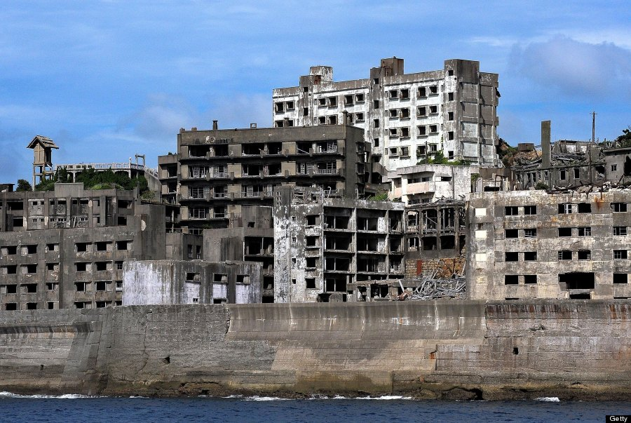 "NAGASAKI, JAPAN - JULY 13: (JAPANESE NEWSPAPERS OUT) The ruined buildings of Hashima, famous as the nickname ""Gunkan jima (Warship Island)"", are seen on July 13, 2009 in Nagasaki, Japan. The Island had been a coal complex and more than 5,000 people resided in 1960s, now uninhabited and only accept reserved visitors. (Photo by Sankei/Getty Images)"